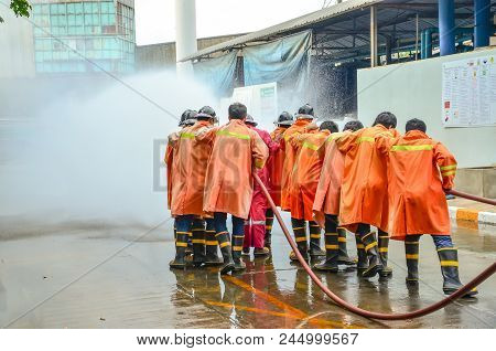 Firefighters Train Firefighters With Fire Extinguishers In The Factory.