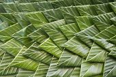 Background of banana leaf that hand make in Thai culture for decoration poster