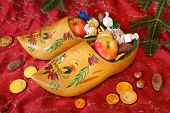 Vintage Wooden Shoes filled with treats for St Nicholas Day poster