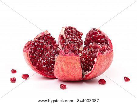 Open Pomegranate Fruit On A White Background. Pomegranate Fruit Close-up. Juicy Pomegranate In The O