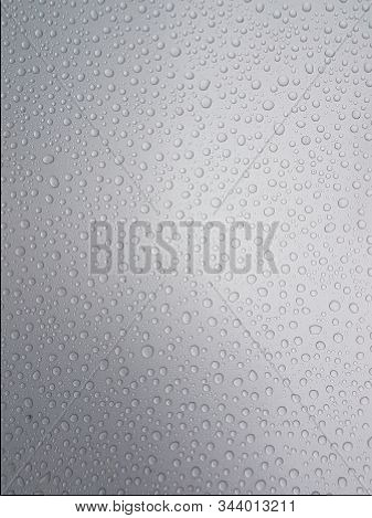 Drops Of Water On A Gray Background With Light Shading