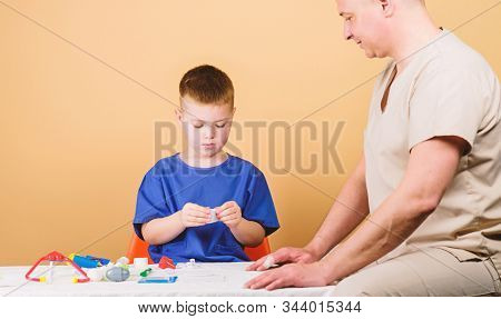 Medical Insurance. First Aid. Medicine Concept. Kid Little Doctor Sit Table Medical Tools. Health Ca