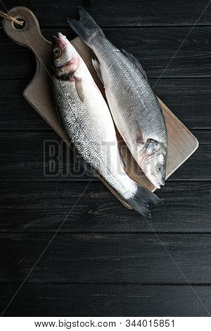 Fresh Seabass . Raw Fish Seabass On Wooden Rustic Table. Top View With Copy Space.