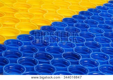 Bottle Caps Made Of Hdpe (high-density Polyethylene) Segregated According To The Colors Prepared For