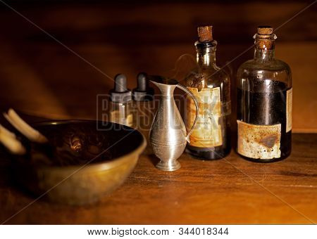 Old Pharmacy Bottles And Bowl With Medicine Mixture, Vintage Still Life