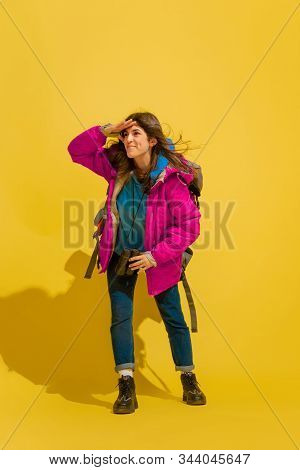 Smiling, Looks Happy. Portrait Of A Cheerful Young Caucasian Tourist Girl With Bag And Binoculars Is