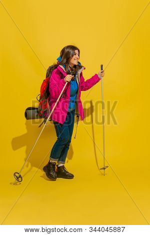 Going To Mountains. Portrait Of A Cheerful Young Caucasian Tourist Girl With Bag And Binoculars Isol