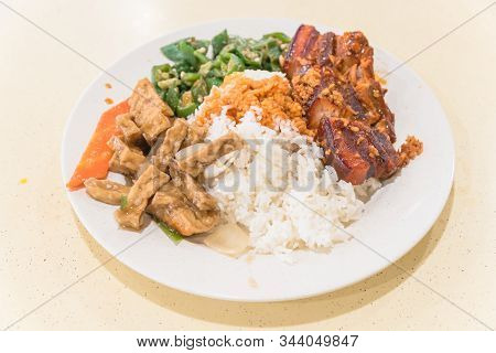 Traditional Chinese Braised Streaky Belly Pork, Tofu And Stir Fry Vegetables