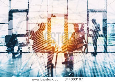 Network Background Concept With Business People Silhouette Working In The Office. Double Exposure An