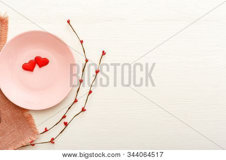 Valentines Day Festive Table Setting On A White Wooden Table. Dinner Meal In Restaurant At Valentine