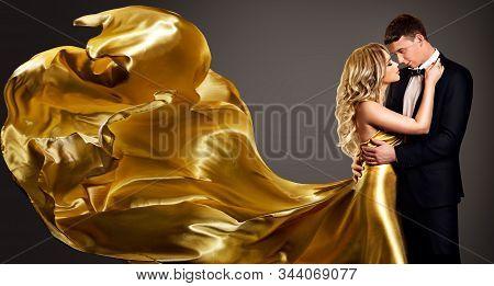 Couple, Fashion Woman In Golden Silk Fluttering Dress Kissing Elegant Man, Valentine S Day Love Conc