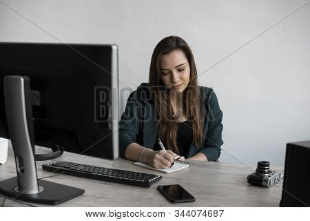 Business Woman Writing Something In Notebook. Start-up Woman Entrepreneur Student Studying Writing N