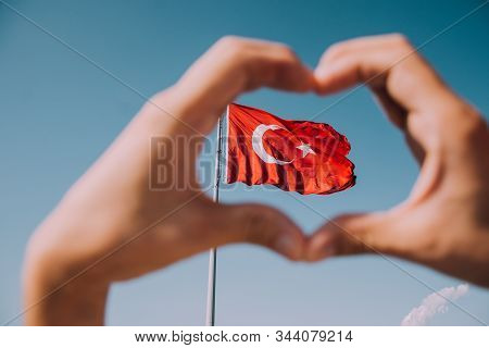 Turkish Flag On Sky Background. Waving Red Flag. Turkish Patriotism. Turkey Day. Cumhuriyet Bayramı.