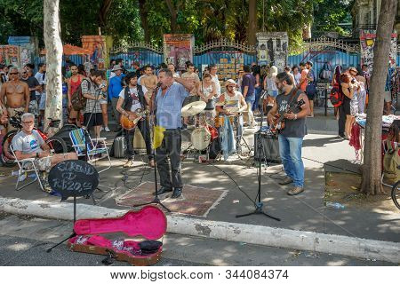 Crowds Looking At Music Performances In Paulista Avenue On Sunday Afternoon. Paulista Avenue Is Clos