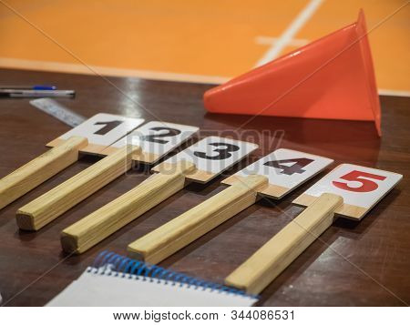 Table Of A Basketball Game With The Number Of Fouls, Notebook, Cone, Scoreboard ... Sport Concept.