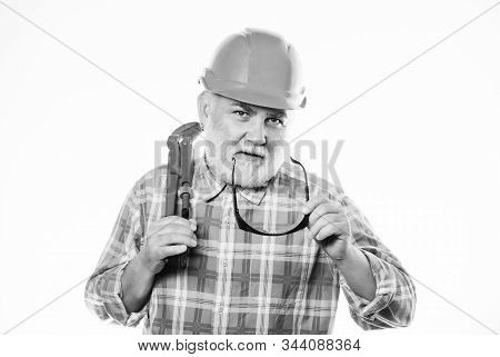 Experienced Engineer. Home Improvement. Plumber Service. Man Bearded Plumber Wear Helmet And Hold Wr
