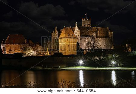 Malbork, Pomerania, Poland - January 1: Castle Of The Teutonic Order In Malbork By Night - The Large