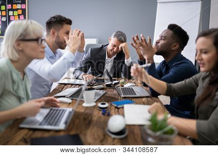 Frustrated Businessman During A Business Meeting In Office