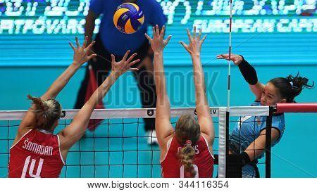 BUDAPEST, HUNGARY – August 23, 2019: Yelyzaveta Samadova (8) hits the ball, at the Croatia(red) – Azerbaijan (blue) 2019 CEV Volleyball European Championship's women volleyball game.