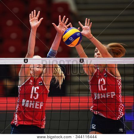 BUDAPEST, HUNGARY – August 23, 2019: Bernarda Brcic (L) and Beta Dumancic (R) block the ball, at the Croatia(red) – Azerbaijan (blue) 2019 CEV Volleyball European Championship's women volleyball game.