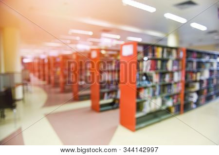 Library Books / Blurred Image Many Books On Bookshelf In Library