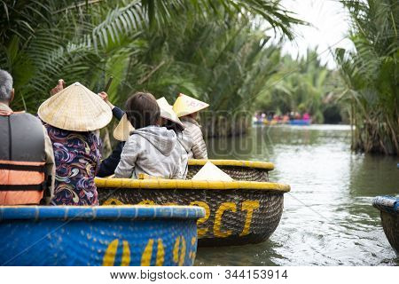 Hoi An,vietnam-december 9,2019: Tourists Enjoy Round Basket Boat Made Of Bamboo Is A Unique Vietname
