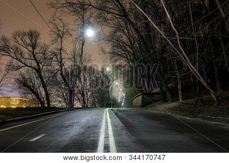 image of a dark night road