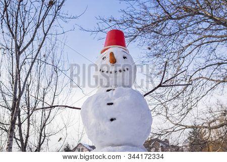 Snowman Under Blue Sky On A Winter Day