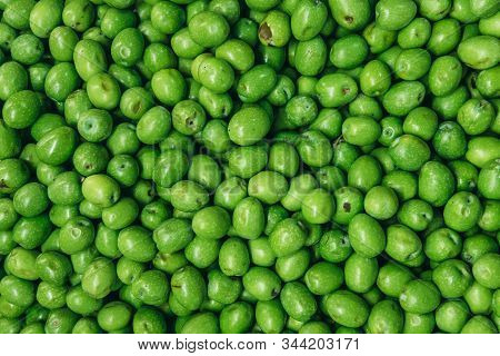 Heap Of Green Raw Olives On A Indoor Food Market Called Mercato Delle Erbe In Bologna City, Italy