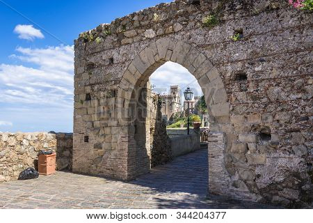 Historica Gate In Savoca, Small Town On Sicily In Italy, View With Saint Nicholas Church Also Called