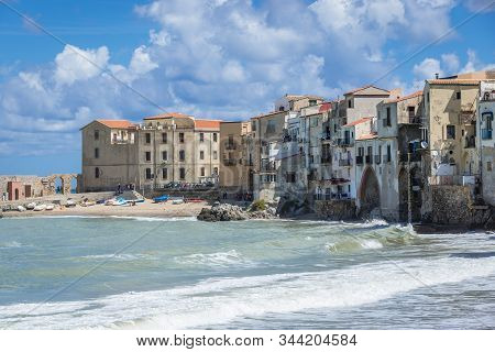 Residential Buildings On The Tyrrhenian Sea Shore In Cefalu City On Sicily Island In Italy