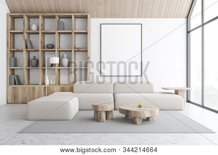 Interior Of Attic Living Room And Home Library With White Walls, Comfortable White Sofa Standing Nea