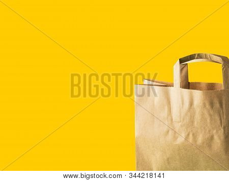 Brown Kraft Paper Grocery Shopping Bag On Yellow Background. Plastic-free Zero Waste Eco Friendly Ma