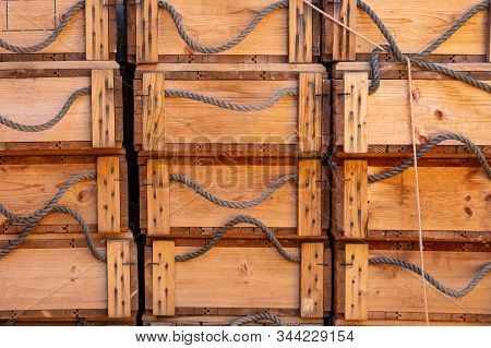 Crates Boxes Wood With Ropes As Handle In Columns, Full Background Texture. Stacked Crates For Stora
