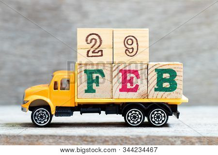 Truck Hold Letter Block In Word 29feb On Wood Background (concept For Date 29 Month February , Leap