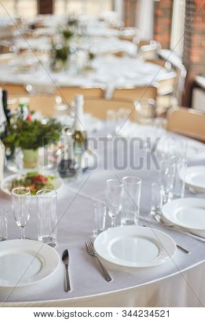 Table Set For An Event Party Or Wedding Reception. Banquet Table Design. Festive Table Setting. Glas