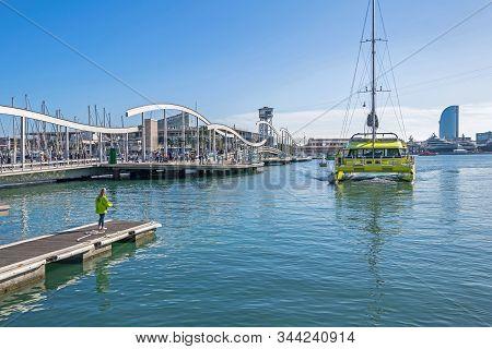 Barcelona, Spain - November 2, 2019: Port Vell With Sailing Catamaran, Its Tourist Attraction Marema