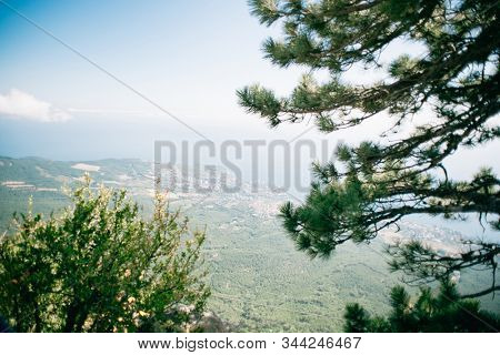 Landscape of Crimea, Russia. Panoramic view of Crimea near Alupka Town. Southern coast of Crimea. View from Ai Petri. Black Sea on Background.