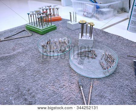 Dental Diamond Milling Cutter On Table.  Dental Bur Set, Dentist Equipment,