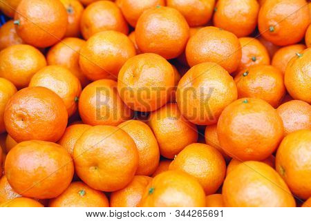 Tangerines Or Fresh Mandarin Oranges Fruit As Background. Organic Tangerine Fruit For Sale At Market