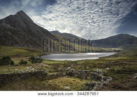 Majestic Sky Over Landscape Of Tryfan And Llyn Ogwen In Snowdonia Wales