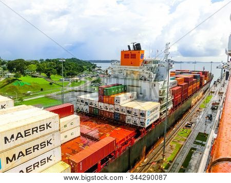 Panama Canal, Panama - December 7, 2019: A Cargo Ship Entering The Miraflores Locks In The Panama Ca