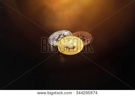 Bitcoin On A Dark Background. Economic Crisis.