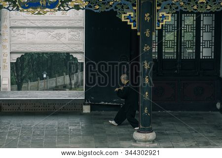 Chongqing, China - Dec 19, 2019: Old Chinese Man Practice Tai Chi Martial Art In The Morning In Anci