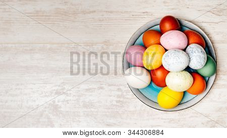 Plate Full Of Multi Coloured And Mottled Easter Eggs. Plate Full Of Eggs On Vintage Reclaimed Oak Ta