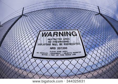 Airport Fence Warning Sign Shot With A Fish-eye Lens