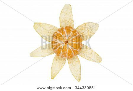 Isolate Of Peeled Fresh Ripe Tangerine With Peel Isolated On White Background. Top View. Healthy Veg