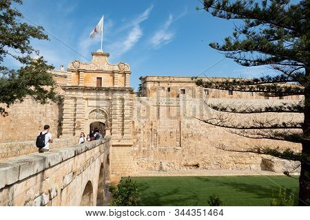 Mdina, Malta - October 2018: Bridge And Mdina Gate To The Historical Complex Of Buildings Ner Il-rab