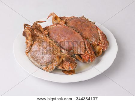 Steamed Blue Crabs On White Dish Isolated On White Background