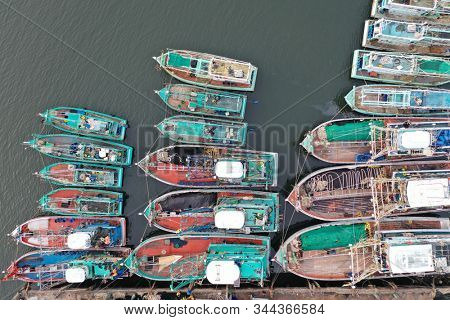 Fishing boats in port in Thailand. Overfishing environmental problem. Khura Buri, Andaman Sea, Thailand